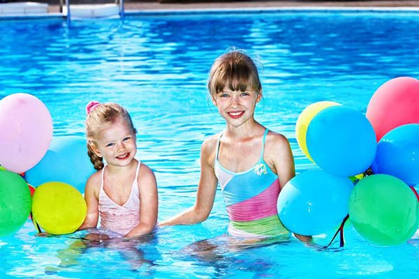 Kids with balloons in a pool