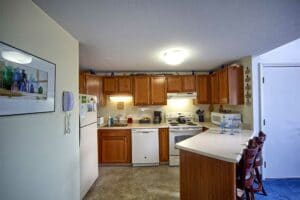 Eat-in Kitchen with oak cabinets helps simplify your wells maine vacation