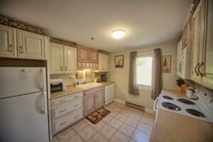 Kitchen with whitewash cabinets in our wells maine vacation rentals