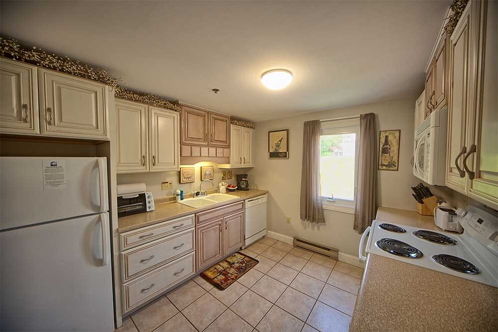 Kitchen with whitewash cabinets