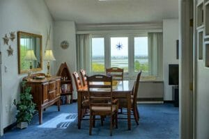 Dining room overlooking marsh in our wells maine vacation rentals