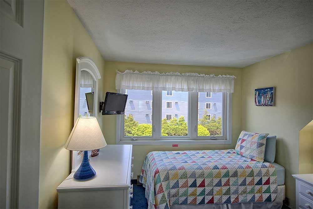 Bedroom with bright windows