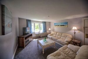 Living room with white comfortable couches with wells maine vacation rentals