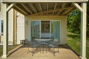 Patio with table and chairs at Maine vacation rental