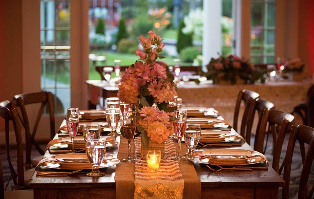 Wedding table with places and flowers at Maine Wedding Venue near beach