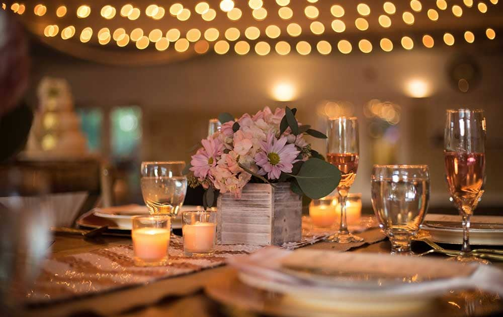 Wedding table setting with candles and flowers