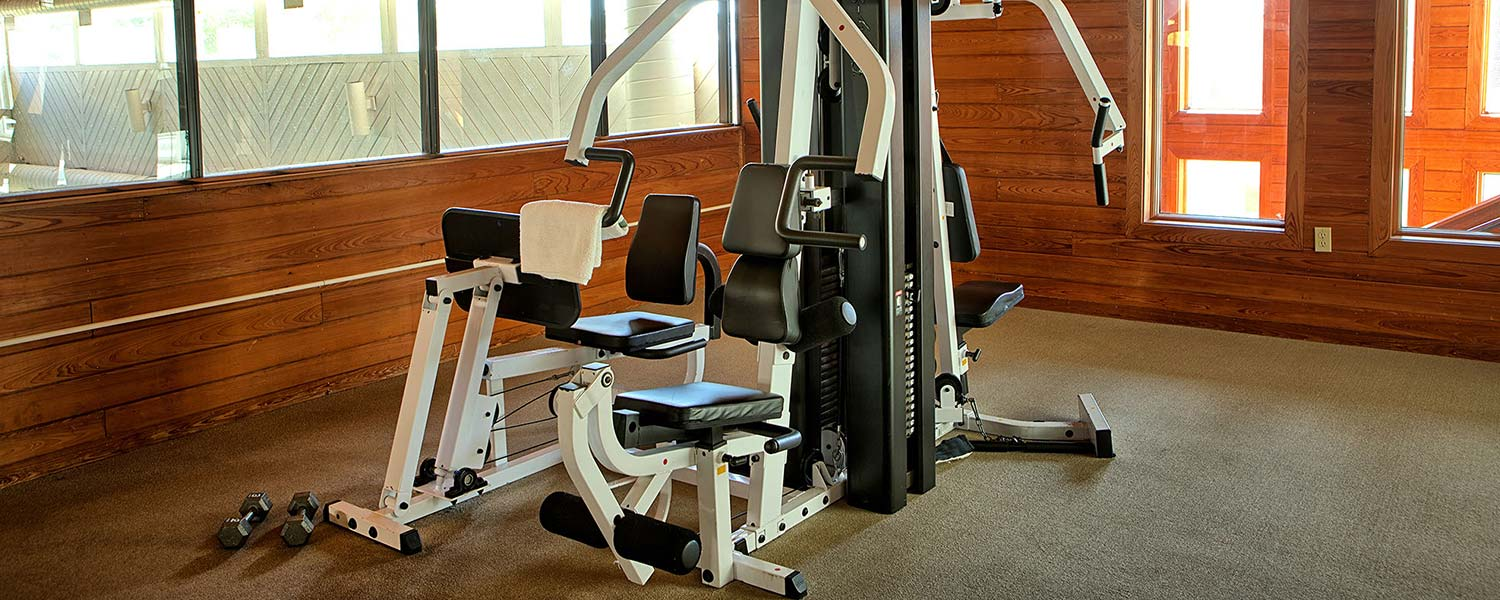 Fitness center with weights and exercise equipment at Wells, Maine hotel